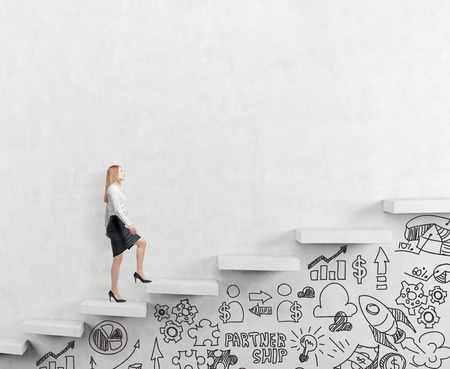 climbing ladder: determined businesswoman climbing a carrer ladder, businessicons drawn under the ladder, white background, concept of success and career growth Stock Photo