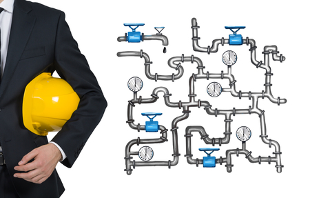 Man in a suit holding a yellow helmet, illustration of sophisticated pipeline on the white background. Concept of oil transportation