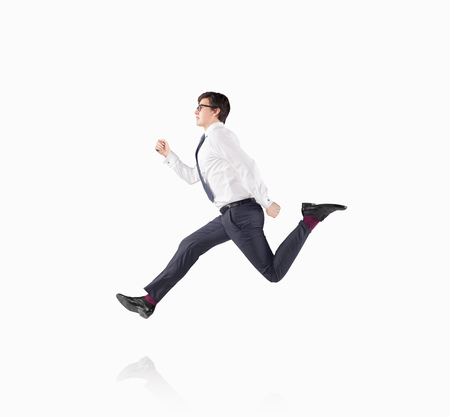 schemes: A young handsome businessman wearing a shirt and glasses as if running. Concept of approaching an aim.