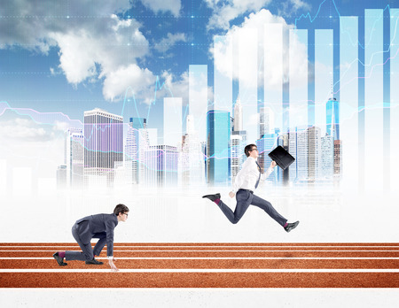 crouch: Two young businessmen competing on the track. One in crouch start, the other running forward with a black folder. New York, blue sky and graphs at the background. Concept of competition. Stock Photo