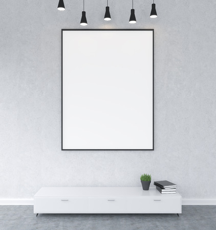 big five: A big blank frame hanging on the wall above a shelf, books and a pot with a plant on the shelft, five lamps on the ceiling. Concrete background. Front view. Concept of demonstration. Stock Photo