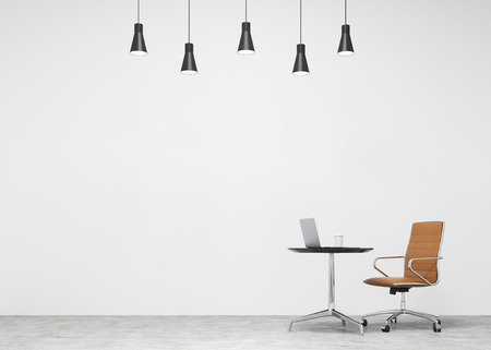 individual: A brown leather castor chair at a small table with a laptop and a glass of coffee on it, five lamps above. Concrete background. Concept of individual work. Stock Photo