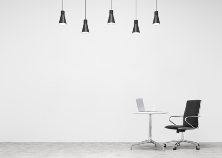 individual: A black leather castor chair at a small table with a laptop and a glass of coffee on it, five lamps above. Concrete background. Concept of individual work.