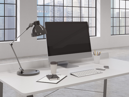 note pad and pen: Workplace in the office, computer, keyboard, mouse, smartphone, lamp, note pad, pen, pencil glass, coffee on the table, window behind the table, Singapore at the background. Concept of work