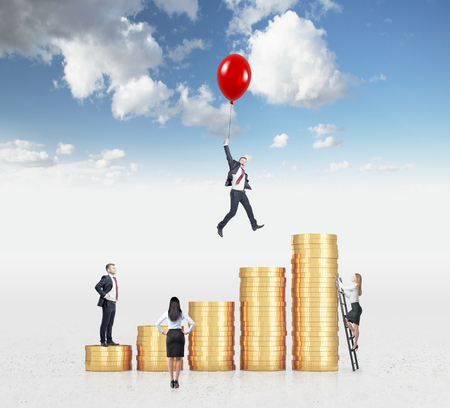 wallstreet: Businessman flying on a red baloon over a bar chart made of coins, another man standing on the lowest bar, woman climbing a ladder, another woman looking at them. Sky background. Concept of success.