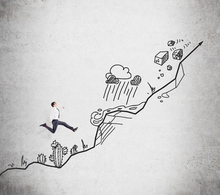 obstacles: Young businessman climbing up, a picture of a steep path with obstacles such as cactus, mountain, storm, stonefall at the background. Concept of growth.