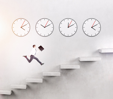 career timing: A young man with a folder running upstairs, four clocks on the white wall over seven steps. Concept of career growth.