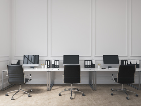 facing each other: An open space office, tables with computers arranged along the wall, workers facing each other. Concept of work. 3D rendering Stock Photo