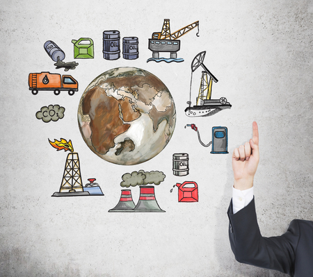 An index finger pointing up at pictures symbolizing stages of oil production  arranged in a circle. Brown Earth in the centre. Concrete background. Concept of environmental pollution. Stock Photo