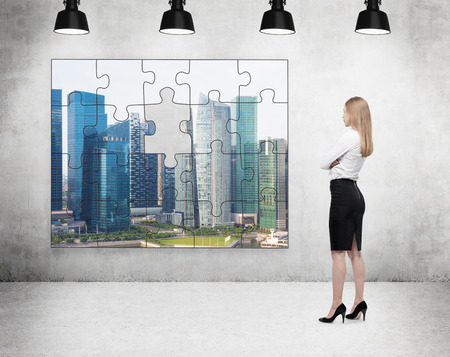 full of holes: A businesswoman standing with arms crossed in front of a puzzle on the concrete wall with a picture of Singapore, one part missing, four lamps on the ceiling. Concept of getting the full picture.