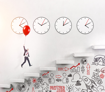 career timing: A happy young man flying up over stairs on a red balloon, four clocks on the white wall over seven steps, business signs painted on the wall under the stairs. Concept of career growth.