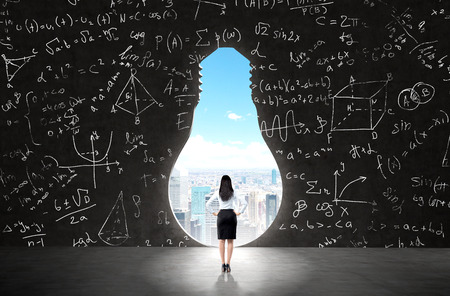 new horizons: businesswoman with hands on hips standing in front of a huge keyhole of the bulb shape, Maths icons to the sides. New York seen in the hole. Back view. Concept of opening new horizons.