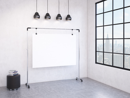 pouffe: A portable blank white board in the corner of the room, window with a city view to the right, black pouffe to the left, four black lamps above. Concept of demonstration. 3D rendering Stock Photo
