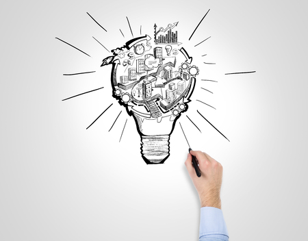 flexible business: A hand drawing with a pen a picture of a bulb with stages of organizing a business process in it. White background. Concept of organizing a business.