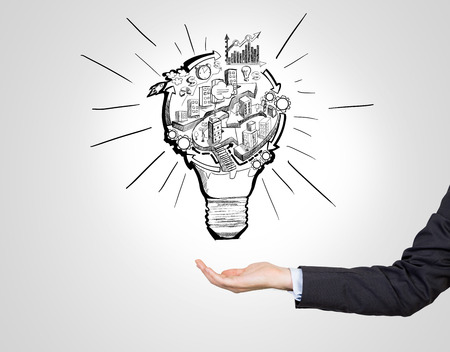 business opportunity: A hand as if holding a picture of a bulb with stages of organizing a business process in it. White background. Concept of organizing a business. Stock Photo