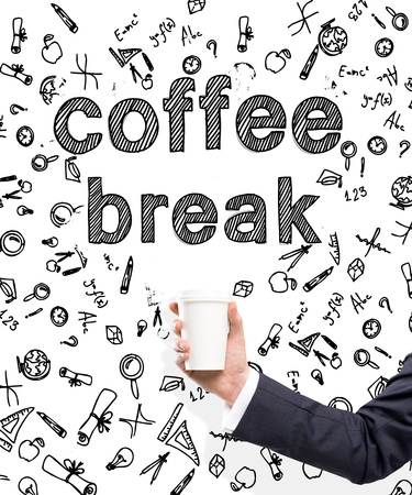 anecdote: A hand in a black suit holding a paper cup. Coffee break written over it. White background with different scientific symbols. Concept of coffee break.