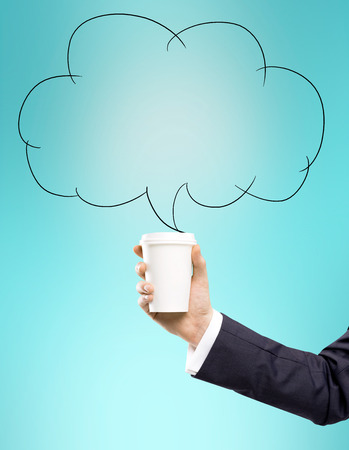 anecdote: A hand in a black suit holding a paper cup. A cloud for remarks drawn over it. Turquoise background. Concept of coffee break.