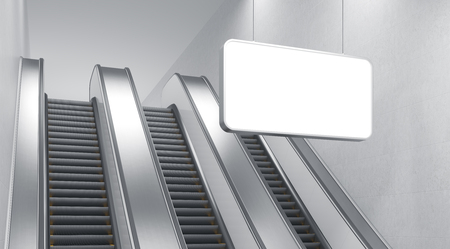 itc: An escalator in the underground. A blank horizontal poster hanging in front of it.c Side view. Concept of underground advertising. 3D rendering Stock Photo