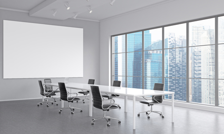 A meeting room with a table in the center, a laptop on it, seven black chairs around it. A blank frame on the white wall. Window to the right. Concept of negotiations. 3D rendering Foto de archivo