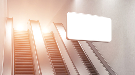 itc: An escalator in the underground. A blank horizontal poster hanging in front of it.c Side view. Filter. Concept of underground advertising. 3D rendering