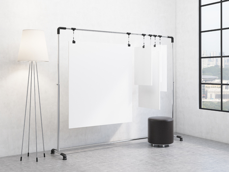 pouffe: A portable rack for paper in the corner of the room, paper sheets clipped to it, window with a city view and a pouffe to the right, standard lamp to the left. Concept of demonstration. 3D rendering