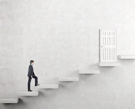 steadily: A young businessman going upstairs steadily, a white closed door in the wall at the top. White background. Concept of career growth.