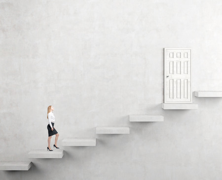 steadily: A young businesswoman going upstairs steadily, a white closed door in the wall at the top. White background. Concept of career growth. Stock Photo