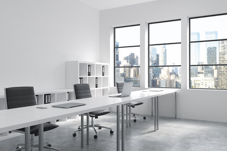open windows: A row of tables leading to windows in an open space office. Computers on them, shelves with folders behind. New York view in windows. Concept of a modern office. 3D rendering