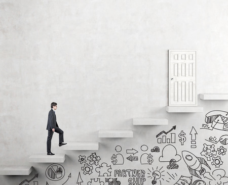 steadily: A young businessman going upstairs steadily, a white closed door in the wall at the top, business icons drawn below the steps. White background. Concept of career growth.