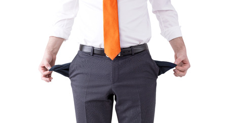 pension cuts: A businessman with an orange tie turning his empty pockets inside out. Front view, no head. Isolated. Concept of bankruptcy.