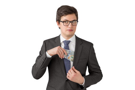 putting money in pocket: Sly man putting one hundred dollar banknotes into the chest pocket. Isolated. Concept of getting money. Stock Photo