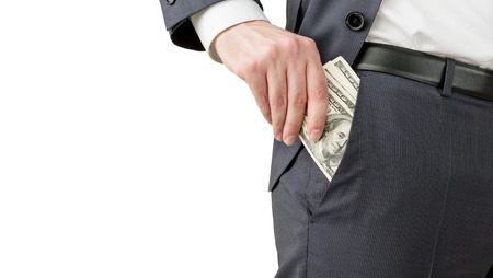 putting money in pocket: Man putting one hundred dollar banknotes into the pocket. No head seen. Isolated. Concept of earning money. Stock Photo