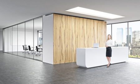 Office, white reception at wooden wall. Businesswoman in front. Panoramic window right, meeting room behind. Concept of reception.