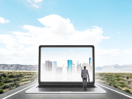 expectations: Businessman standing on highway in front of huge laptop screen with image of New York. Blue sky at background. Concept of expectations.