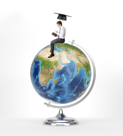 transnational: Man with book sitting on terrestrial globe, academic hat over him. Concept of studying. Elements of this image furished by NASA.