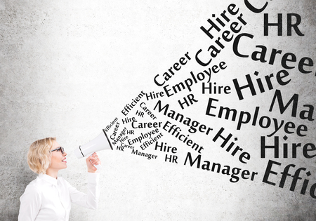 informing: Businesswoman holding white loudspeaker, many employment words from it. Concrete background. Concept of informing. Stock Photo