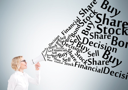 informing: Businesswoman holding white loudspeaker, many business words from it. Grey background. Concept of informing. Stock Photo