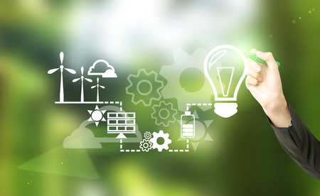 illustrate: Hand drawing symbols of alternative energy sources. Blurred green background. Concept of clean environment. Stock Photo