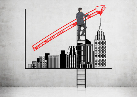 progressively: Businessman on ladder painting red arrow over progressively tall New York buildings drawn on the wall.   Concept of growth.