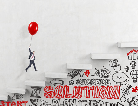 business it: Businessman flying upstairs on red balloon, business icons and words under it. Concrete background. Stock Photo