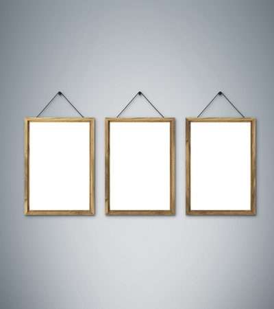 grey nails: Three blank wooden frames on nails. Grey background. Concept of picture on wall. Mock up. 3D render