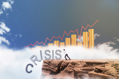 coping: Businessman pushing letters of word crisis from rock. Blue sky and yellow bar charts at background. Concept of coping with crisis.