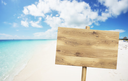 sign post: Wooden nameboard on beach. Sea and sky at background. Concept of information. Mock up. 3D render