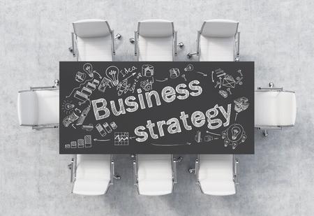reuniones empresariales: mesa de negro para reuniones, iconos de negocio en él, ocho sillas blancas alrededor. piso de concreto, vista desde arriba. Concepto de la reunión. render 3D. Foto de archivo