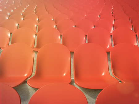 anti noise: Red plastic seats at stadium, front view. Toned, filter. Concept of stadium. 3D render