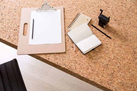 datebook: Cork table with notepad, datebook, pencil and sharpener. Concept of work. Mock up. 3D render Stock Photo
