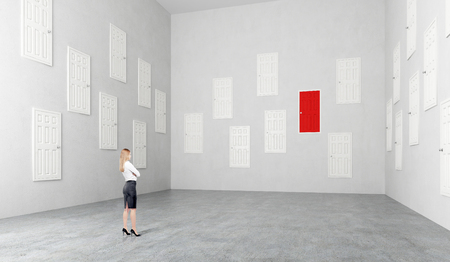 subconsciousness: Businesswoman standing in room with many white doors, one red, Concept of choice. Stock Photo