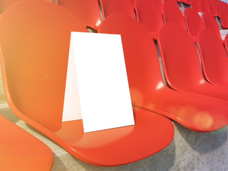 gazer: Placard on red seat at stadium. Close up. Concept of sport advertising. Mock up. 3D rendering