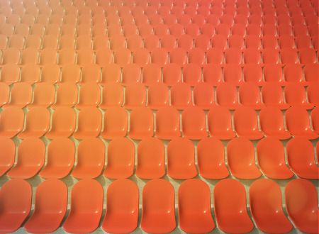 gazer: Rows of red plastic seats at stadium, front view. Filter, toned. Concept of stadium. 3D rendering