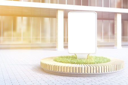 flowerbed: Blank advertising poster in flowerbed, building at background. Toned, filter. Concept of city advertising. Mock up. 3D rendering Stock Photo